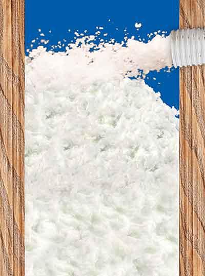 Fotomontage Einblasdämmung - Holzbau